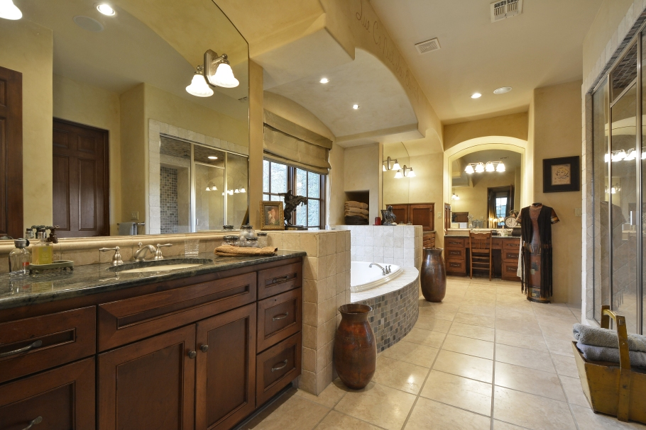 Master Bath has custom cabinetry with highend granite counter tops